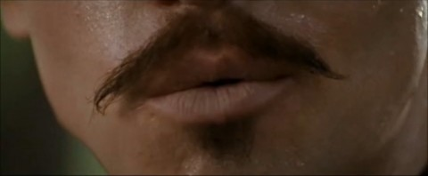 Tilt down to an extreme close up of Doc's mouth as he taunts Ringo...